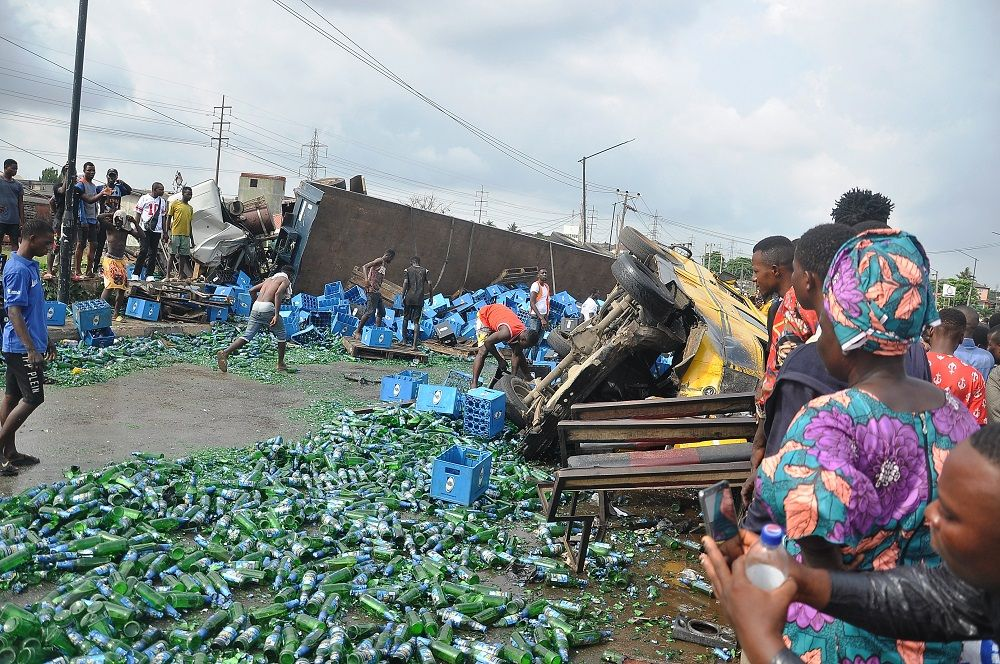 Two Dead, Many Injured As Trailer Conveying Drinks Collides With Bus At Iyana-Ipaja, Lagos 3