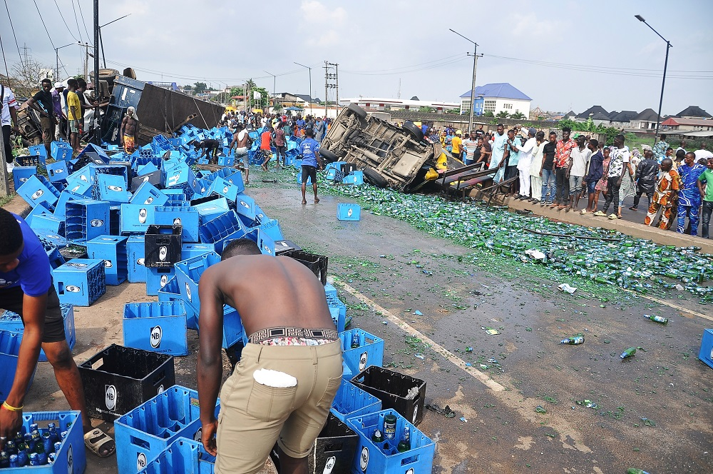 Two Dead, Many Injured As Trailer Conveying Drinks Collides With Bus At Iyana-Ipaja, Lagos 4