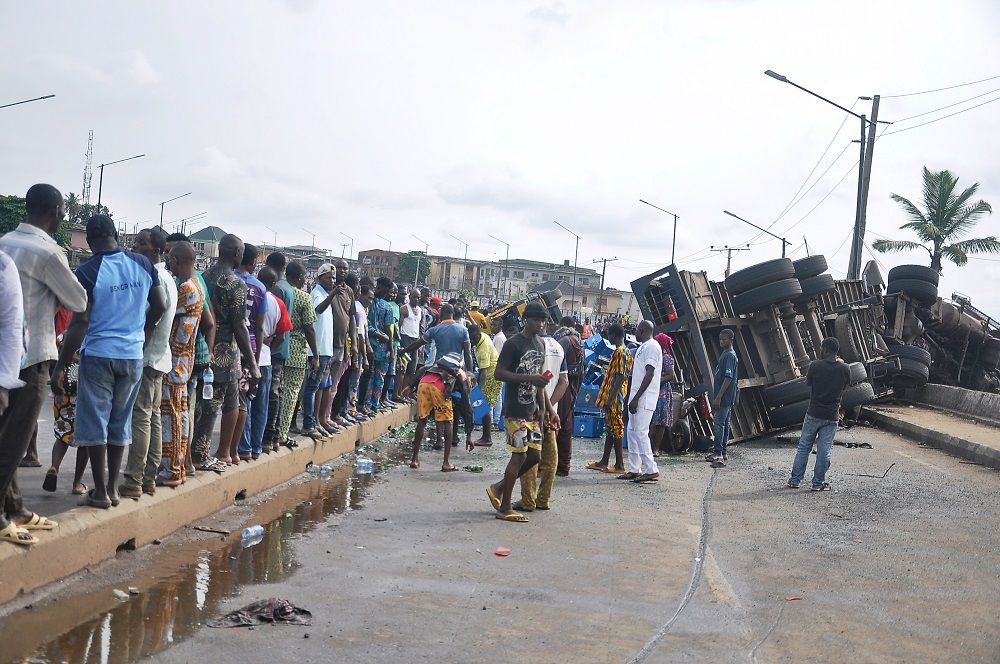 Two Dead, Many Injured As Trailer Conveying Drinks Collides With Bus At Iyana-Ipaja, Lagos 5